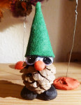 Pine cone gnome with green hat